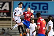 Western Sydney Wanderers midfielder Marc Tokich (18) and Bonnyrigg White Eagles Forward Aaron Peterson (9) go up for the ball at the FFA Cup Round 16 soccer match between Bonnyrigg White Eagles FC v Western Sydney Wanderers FC at Marconi Stadium in Sydney.
