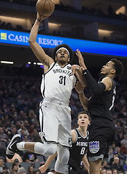 March 1, 2018 - Sacramento, CA, USA - The Brooklyn Nets' Jarrett Allen (31) dunks against the Sacramento Kings' Skal Labissiere in the first quarter at the Golden 1 Center in Sacramento, Calif., on Thursday, March 1, 2018. (Credit Image: © Hector Amezcua/TNS via ZUMA Wire)