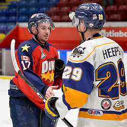 WHITBY, ON  - MAR 14,  2017: Ontario Junior Hockey League, playoff game between the Whitby Fury and Wellington Dukes. Colin Doyle #17 of the Wellington Dukes shakes hands with Ryan Heeps #29 of the Whitby Fury.<br /> (Photo by Shawn Muir / OJHL Images)