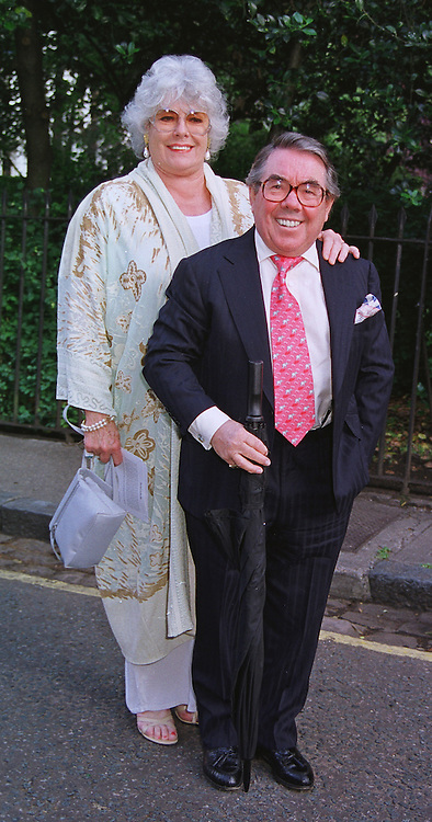 MR & MRS RONNIE CORBETT he is the comedian, at a party in London on 30th June 1999.MTY 25