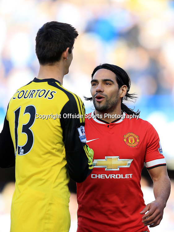 18 April 2015 - Barclays Premier League - Chelsea v Manchester United - Radamel Falcao of Manchester United with Thibaut Courtois of Chelsea - Photo: Marc Atkins / Offside.