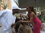 **EXCLUSIVE**.Chris Tucker & Holly Robinson Peete.Cain at the Cove Hotel Opening.Kaimilla Fashion Show at the Cain pool.Paradise Island, Bahamas.Friday, May 11, 2007 .Photo By Celebrityvibe.To license this image please call (212) 410 5354; or.Email: celebrityvibe@gmail.com ;