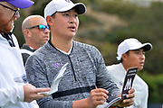 Carl Yuan, from the University of Washington, looks at his yardage book on the 2nd tee. College players were paired with tour pros during the Collegiate Showcase during the Genesis Open at Riviera Country Club. The low scoring college player will get an exemption to play in the tournament that begins on Thursday. Los Angeles, CA 1/025/2018 (Photo by John McCoy)