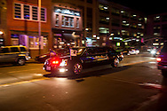 Vice President Joseph R. Biden's motorcade passes down U Street en route to the Inaugural Ball on Monday, January 21, 2013 in Washington, DC.
