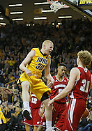 January 19 2013: Iowa Hawkeyes forward Aaron White (30) is pumped up after a dunk during the first half of the NCAA basketball game between the Wisconsin Badgers and the Iowa Hawkeyes at Carver-Hawkeye Arena in Iowa City, Iowa on Sautrday January 19 2013. Iowa defeated Wisconsin 70-66.