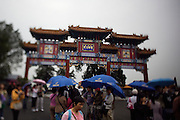 Imperial Summer Palace (Yihe Yuan). Kunming lake. Yunhuiyuyu Archway. Tourists with umbrellas.
