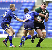 04/05/2002.Sport - Rugby Union.Zurich Premiership.London Irish vs Sale.Eddie Halvey, tackled by Jason Robinson ...[Mandatory Credit, Peter Spurier/ Intersport Images].