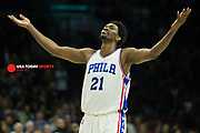 Nov 21, 2016; Philadelphia, PA, USA; Philadelphia 76ers center Joel Embiid (21) reacts as time winds down on a victory against the Miami Heat at Wells Fargo Center. The Philadelphia 76ers won 101-94. Mandatory Credit: Bill Streicher-USA TODAY Sports