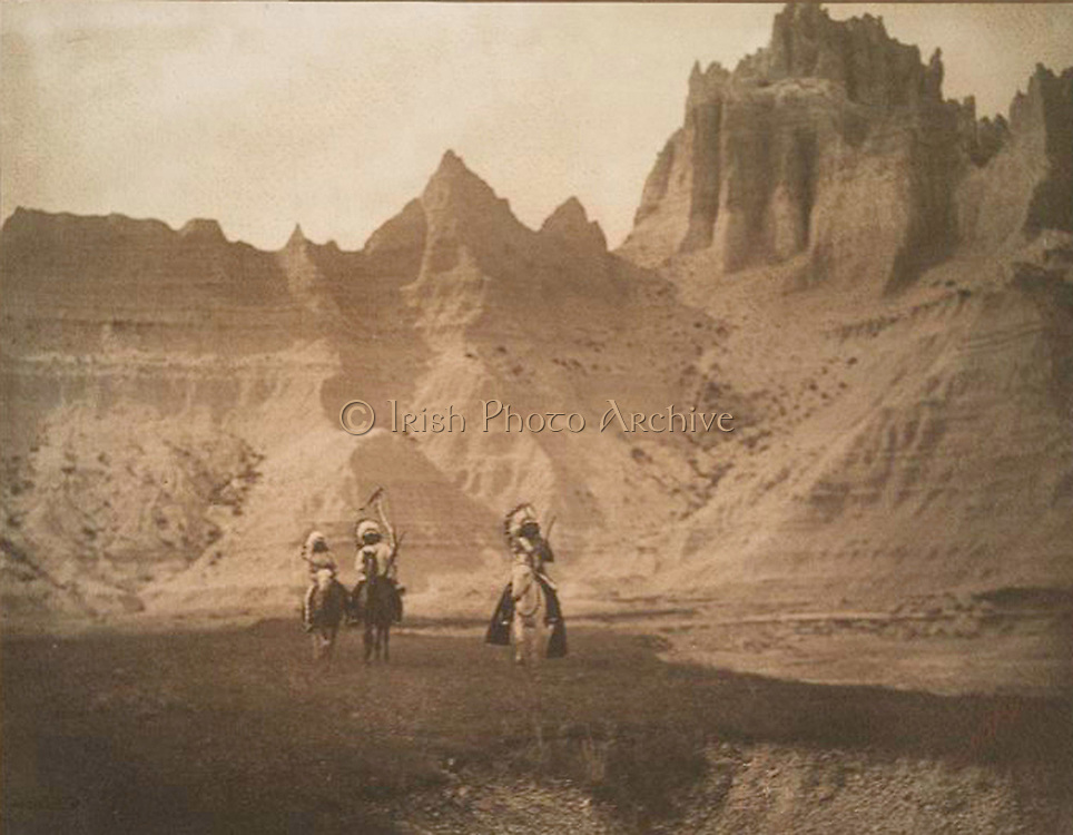 Sheep Mountain.  Native American Indian Sioux mountain sheep hunters in the Bad Lands of South Dakota c1905.