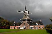 Roderwolde (Drents: Rowol) is a village in the Dutch province Drenthe. Eye-catcher in the village is the large wind mill Woldzigt from 1852 that still regular works. Unique for this mill is that these can be used both for grinding grain and for 'beating' oil.<br /> <br /> Roderwolde (Drents: Rowol) is een dorp in de kop van de Nederlandse provincie Drenthe, behorend tot de gemeente Noordenveld. Blikvanger in het dorp is de grote windmolen Woldzigt uit 1852 die nog regelmatig in bedrijf is. Uniek aan deze molen is dat deze zowel voor het malen van graan als voor het slaan van olie kan worden gebruikt.