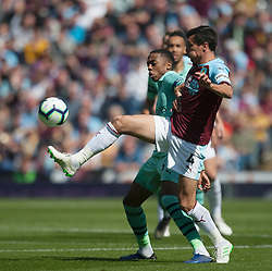 Joe Willock of Arsenal and Jack Cork of Burnley (R) in action - Mandatory by-line: Jack Phillips/JMP - 12/05/2019 - FOOTBALL - Turf Moor - Burnley, England - Burnley v Arsenal - English Premier League