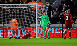WOLVERHAMPTON, ENGLAND - Monday, January 7, 2019: Liverpool's captain James Milner (L) and goalkeeper Simon Mignolet look dejected as Wolverhampton Wanderers scored the first goal during the FA Cup 3rd Round match between Wolverhampton Wanderers FC and Liverpool FC at Molineux Stadium. (Pic by David Rawcliffe/Propaganda)