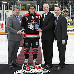 TRENTON, - Apr 15, 2016 -  Ontario Junior Hockey League game action between Trenton Golden Hawks and the Georgetown Raiders. Game 1 of the Buckland Cup Championship Series. At the Duncan Memorial Gardens, ON. 2015-2016 OJHL Awards presentation for Most Gentlemanly Player. Presented by OJHL Chairman of the Board of Governors Scott McCrory, Gary Moroney Vice Chairman of the Board Ontario Hockey Association and OJHL Commissioner Marty Savoy.<br /> (Photo by Tim Bates / OJHL Images)