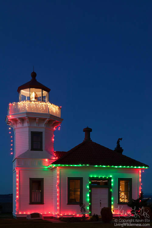The Mukilteo Light, shown here decorated for the holidays, began operating in 1906 in Mukilteo, Washington. One of the few lighthouses made out of wood, the Mukilteo Light lighthouse was placed on the National Register of Historic Places in 1977 and automated two years later. The lighthouse is now maintained by the Mukilteo Historical Society.