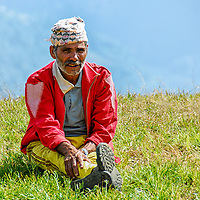 Nepalese village school teacher having a break