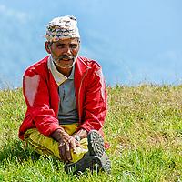 Nepalese village school teacher having a break