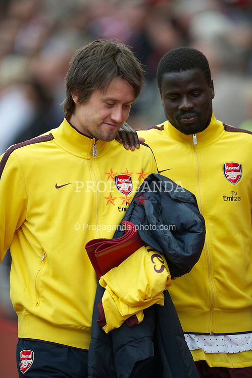 STOKE-ON-TRENT, ENGLAND - Sunday, May 8, 2011: Arsenal's substitutes Tomas Rosicky and Emmanuel Eboue during the Premiership match against Stoke City at the Britannia Stadium. (Photo by David Rawcliffe/Propaganda)
