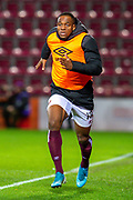 Uche Ikpeazu (#19) of Heart of Midlothian FC warms up before coming on a substitute during the Ladbrokes Scottish Premiership match between Heart of Midlothian FC and Livingston FC at Tynecastle Park, Edinburgh, Scotland on 4 December 2019.