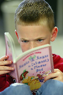 Intense young reader at Seabury School, Tacoma, WA.  (Photo/John Froschauer)