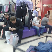 Shopping with Their Ladies: The 'Miserable Men' ofInstagram<br /> <br /> miserable_men is a parody Instagram account that shares candid photos of men shopping with their ladies at the mall. Of course it goes both ways when couples shop together; but the purse holding, phone staring, and the ultimate—the pass out—make for a pretty entertaining Instagram feed that has ballooned to over 50,000 followers in the last couple weeks.<br /> ©miserable_men/Exclusivepix