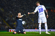 Francisco Casilla of Leeds United (33) fist bumps Pontus Jansson of Leeds United (18) during the EFL Sky Bet Championship match between Leeds United and West Bromwich Albion at Elland Road, Leeds, England on 1 March 2019.