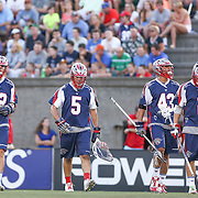 Members of the Boston Cannons take the field during the game at Harvard Stadium on August 9, 2014 in Boston, Massachusetts. (Photo by Elan Kawesch)
