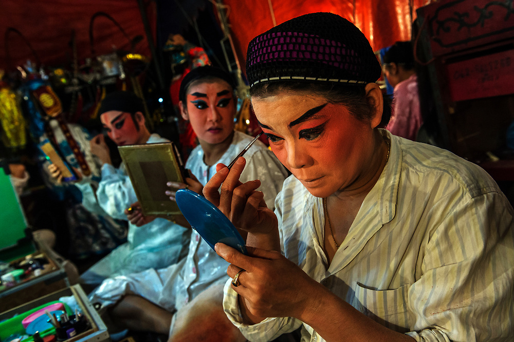 Members of the Sai Yong Hong traditional Chinese Opera troupe prepare for a performance in a temple on Soi Suun Phlu, Bangkok.