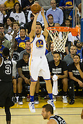 Golden State Warriors guard Klay Thompson (11) shoots a three pointer against the San Antonio Spurs at Oracle Arena in Oakland, Calif., on October 25, 2016. (Stan Olszewski/Special to S.F. Examiner)