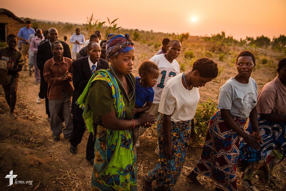 Parishioners of the Confessional Lutheran Church–Malawi Synod sing a hymnody procession as they leave their stone church on Friday, Sept. 25, in Kasungu, Malawi. LCMS Communications/Erik M. Lunsford