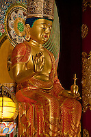 A beautiful, large, gilt seated Buddha figure in a temple in Singapore, Asia.