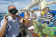 Handing out snorkeling equipment aboard Star Clipper.