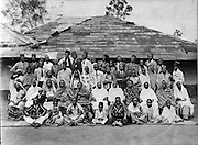 The Nubian community has lived in Kenya for over 100 years and Kibera has been the homeland for generations of Nubian families.  Family and friends gather in the Makina section of 'Kibra' for a group photograph. (1943)