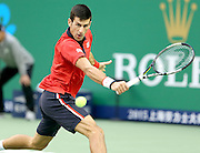 18.10.2015. Shanghai, China. Novak Djokovic of Serbia hits a return against Jo-Wilfried Tsonga of France during their mens singles final match at the Shanghai Masters tennis tournament in Shanghai, China, Oct. 18, 2015. Novak Djokovic won 2-0 and claimed the title.