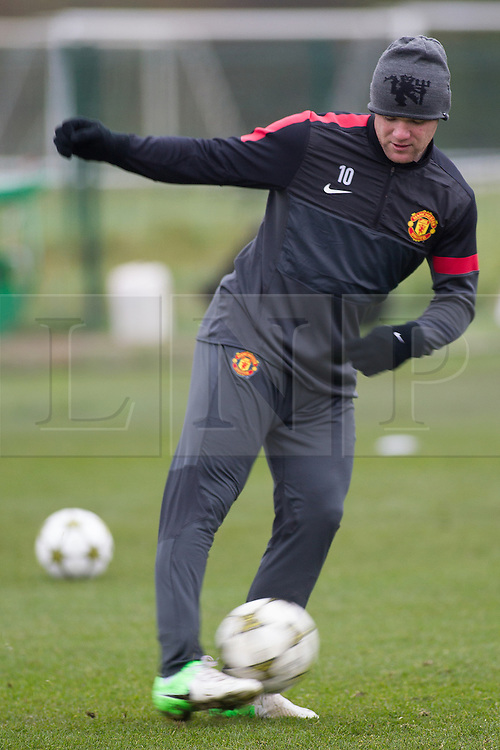 © Licensed to London News Pictures . 06/11/2012 . Manchester , UK . Wayne Rooney . Manchester United players train this morning (6th November 2012) at the club's training facility in Carrington , ahead of their Champions League match against SC Braga in Portugal tomorrow (7th November 2012) . Photo credit : Joel Goodman/LNP