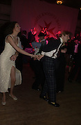 Georgie Cole ( sister of poet Olivia Cole) dancing with Thomas Raynsford. White Knights Ball, Grosvenor House. Park Lane. London. 6  January 2006. ONE TIME USE ONLY - DO NOT ARCHIVE  © Copyright Photograph by Dafydd Jones 66 Stockwell Park Rd. London SW9 0DA Tel 020 7733 0108 www.dafjones.com