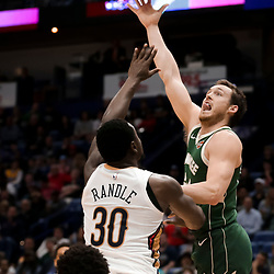 Mar 12, 2019; New Orleans, LA, USA; Milwaukee Bucks guard Pat Connaughton (24) shoots over New Orleans Pelicans center Julius Randle (30) during the second half at the Smoothie King Center. Mandatory Credit: Derick E. Hingle-USA TODAY Sports