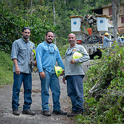 JULY 19, 2018----UTUADO, PUERTO RICO---<br /> Heriberto Velez, Jose Luis Gonzalez and <br /> Jose Ralat  part of a crew from  the Puerto Rico Electric Power Authority  while restoring power to a single family home.<br /> (Photo by Angel Valentin/Freelance)
