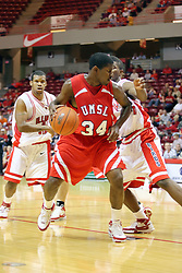 11 November 2007: Larricus Brown backs in towards the basket.. Illinois State Redbirds defeated the Missouri - St. Louis Tritons 70-37 in an early season game on Doug Collins Court in Redbird Arena on the campus of Illinois State University in Normal Illinois.