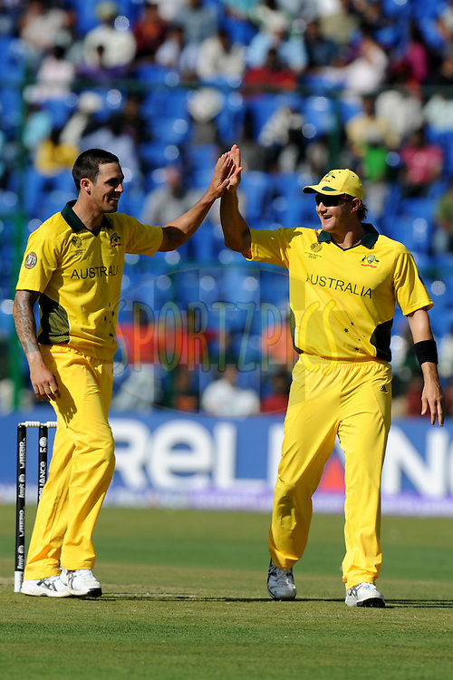Mitchell Johnson of Australia celebrates the wicket of Yuvraj Singh during the World Cup warm up match between India and Australia (B) held at the M Chinnaswamy Stadium in Bengaluru, Bangalore, Karnataka, India on the 13 February 2011..Photo by Pal Pillai/BCCI/SPORTZPICS