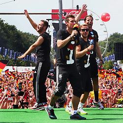 15.07.2014, Brandenburger Tor, Berlin, GER, FIFA WM, Empfang der Weltmeister in Deutschland, Finale, im Bild vl. Shkodran Mustafi (GER), Miroslav Klose (GER), Mario Goetze (GER) und Roman Weidenfeller (GER) beim Tanzen. // during Celebration of Team Germany for Champion of the FIFA Worldcup Brazil 2014 at the Brandenburger Tor in Berlin, Germany on 2014/07/15. EXPA Pictures © 2014, PhotoCredit: EXPA/ Eibner-Pressefoto/ Pool<br /> <br /> *****ATTENTION - OUT of GER*****