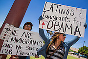 "15 JUNE 2012 - PHOENIX, AZ:   ALEX VAZQUEZ, 11,  (left) and LUPITA CELESTINO-LOPEZ, 19, stand on a street corner in Phoenix Friday to thank President Obama for his immigration announcement. Celestino-Lopez said she is a ""Dreamer"" who was brought to the US illegally by her parents when she was two. President Barrack Obama announced Friday that fffective immediately, young people who were brought to the US through no fault of their own as children and who meet certain criteria will be eligible to receive deferred action for a period of 2 years and that period will be subject to renewal. The announcement of the new executive order means that up to 800,00 young undocumented immigrants will not be deported and can continue their education in the US. The move was seen by many in the immigrant community as the closest thing they would get to seeing the DREAM Act passed in the near future.      PHOTO BY JACK KURTZ"