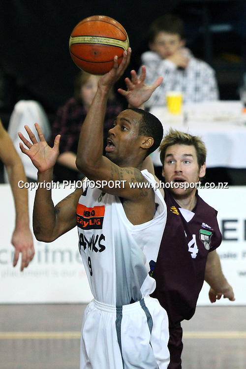 Hawks' Josh Pace shoots over Heat's Dillon Boucher. 2010 NBL Quarter Final, Harbour Heat v Hawke's Bay Hawks, North Shore Events Centre, Auckland. Wednesday 23rd June 2010. Photo: Anthony Au-Yeung/PHOTOSPORT