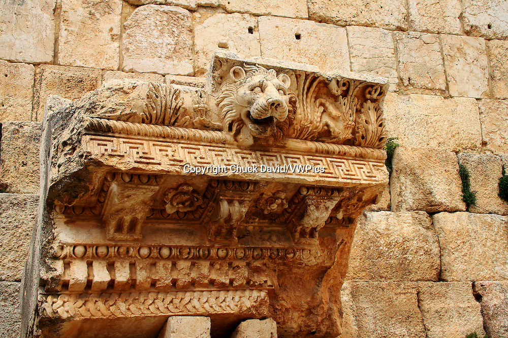 An intricately carved lion's head is part of the motif of an upper block from the Temple of Jupiter in Baalbek, Lebanon.