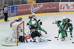 16.09.2012. Hala Tivoli, Ljubljana, SLO, EBEL, HDD Telemach Olimpija Ljubljana vs HC Orli Znojmo, 04. Runde, in picture Anze Ropret (HDD Telemach Olimpija, #29) with puck in front of goalie Ondrej Kacetl (HC Znojmo Orli, #90) during the Erste Bank Icehockey League 4th Round match betweeen HDD Telemach Olimpija Ljubljana and HC Orli Znojmo at the Hala Tivoli, Ljubljana, Slovenia on 2012/09/16. (Photo By Matic Klansek Velej / Sportida)