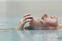 Apr. 07, 2008 - Bath - Older woman meditating in pool. Model and Property Released (MR&PR) (Credit Image: © Cultura/ZUMAPRESS.com)