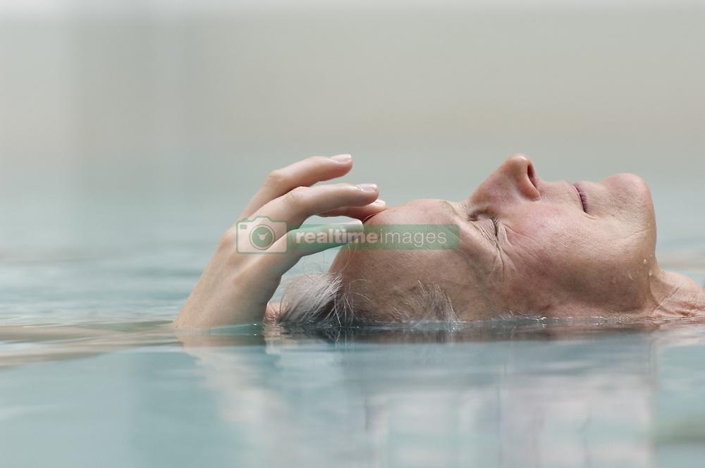 Apr. 07, 2008 - Bath - Older woman meditating in pool. Model and Property Released (MR&PR) (Credit Image: © Cultura/ZUMAPRESS.com)