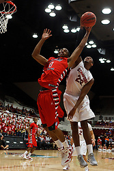 Nov 14, 2011; Stanford CA, USA;  Fresno State Bulldogs forward Jerry Brown (0) and Stanford Cardinal guard Jarrett Mann (22) reach for a rebound during the first half of a preseason NIT game at Maples Pavilion. Mandatory Credit: Jason O. Watson-US PRESSWIRE