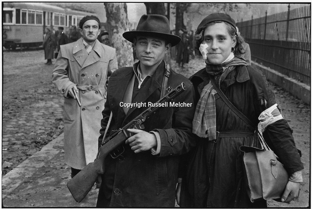 October 1956.Budapest, Hungary. <br /> &quot;Heroes of Budapest&quot;, world famous photo which has become the symbol of the courageous uprising of the oppressed people in Budapest against the Russian occupation.<br /> This photo is currently being used by the hungarian Government on buildings and stamps etc. during the <br /> ceremonies for the 60th anniversary of the uprising.<br /> This was the first picture I took in<br /> Budapest after sneaking across the border.<br /> <br /> Octobre 1956.Budapest , Hongrie.<br /> &quot;H&eacute;ros de Budapest &quot;, photo de renomm&eacute;e mondiale qui est devenue le symbole du soul&egrave;vement courageux du peuple opprim&eacute; &agrave; Budapest contre l'occupation russe .<br /> Cette photo est actuellement utilis&eacute; par le gouvernement hongrois sur les b&acirc;timents et les timbres , etc. pour les<br /> c&eacute;r&eacute;monies du 60e anniversaire du soul&egrave;vement .<br /> Ce fut la premi&egrave;re photo que j'ai prise a<br /> Budapest apr&egrave;s mettre faufiler &agrave; travers la fronti&egrave;re .