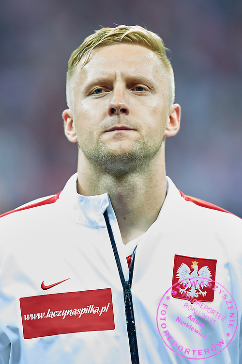 Poland's Kamil Glik while national anthem during the EURO 2016 qualifying match between Poland and Germany on October 11, 2014 at the National stadium in Warsaw, Poland<br /> <br /> Picture also available in RAW (NEF) or TIFF format on special request.<br /> <br /> For editorial use only. Any commercial or promotional use requires permission.<br /> <br /> Mandatory credit:<br /> Photo by &copy; Adam Nurkiewicz / Mediasport