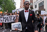 "Nation of Islam at ""Black Lives Matter"" Rally.  Over a thousand people marched through London chanting ""hands up don't shoot"".  The black community was outraged by US police brutality after killing of two black men - one in Minnesota and one in Louisiana."